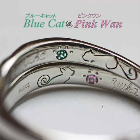 リングの内側にネコの模様と誕生石が入った結婚指輪