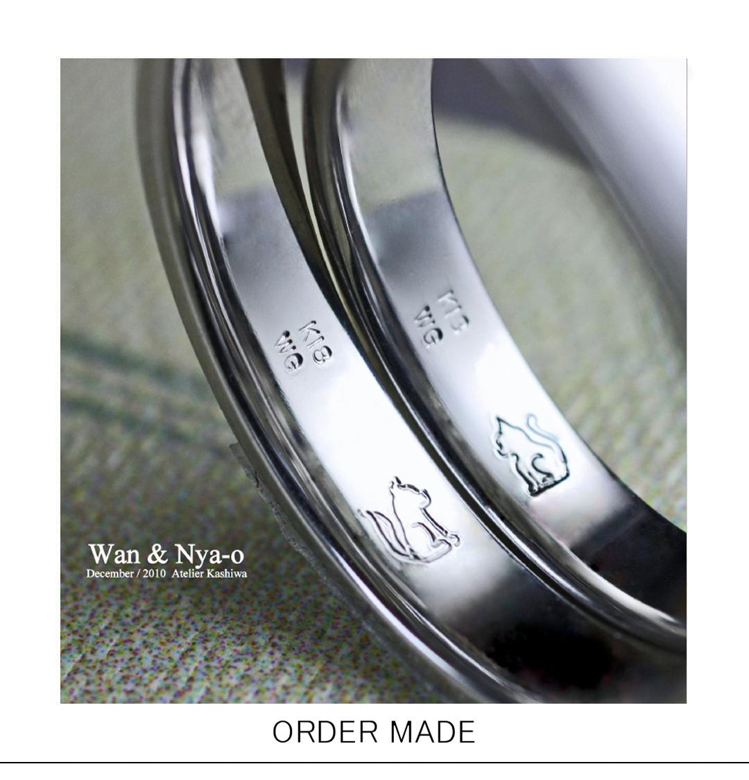 結婚指輪の内側にワンちゃん&ネコちゃんが入ったオーダーリングのサムネイル