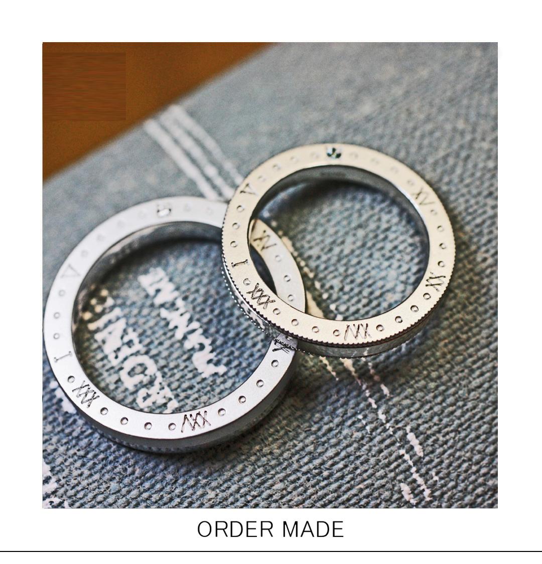結婚指輪にローマ字で二人の記念日をデザインしたオーダーメイド作品のサムネイル