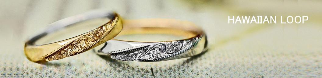 ハワイアン柄が斜めの帯のように入った2カラーのオーダー結婚指輪