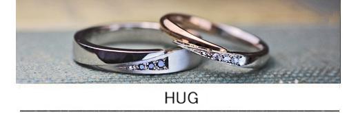 指をハグするブラックダイヤとピンクゴールドの結婚指輪オーダー作品の画像