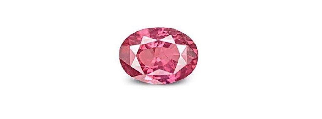 バラの婚約指輪に留めたピンクサファイアの画像