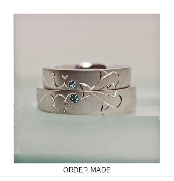 結婚指輪に【イルカ模様】と【ブルーダイヤ】が輝くオーダー作品