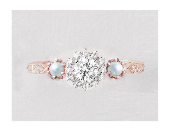 真珠がついたプラチナとピンクゴールドの婚約指輪
