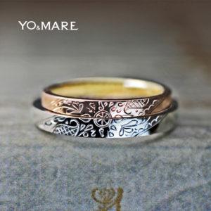 二本重ねて個性的な太陽のモチーフを作った結婚指輪オーダー作品