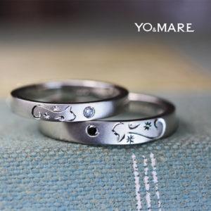 結婚指輪を重ねて黒ネコと白ネコが見つめ合うオーダーメイド作品