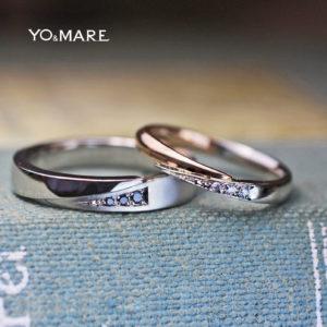 指をハグするブラックダイヤとピンクゴールドの結婚指輪オーダー作品