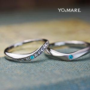 一度見たら忘れない!パライバをVラインに留めたオーダー結婚指輪