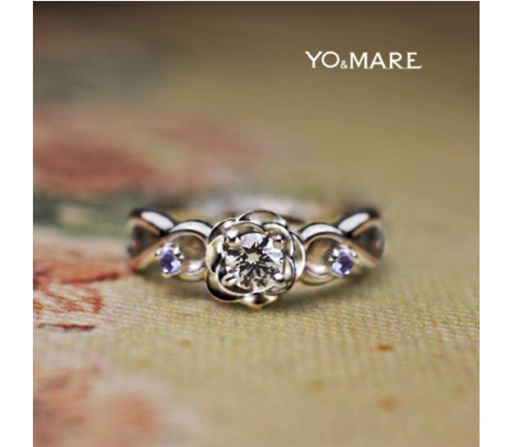 青いバラをイメージしてタンザナイトを添えた婚約指輪のオーダー作品 >>
