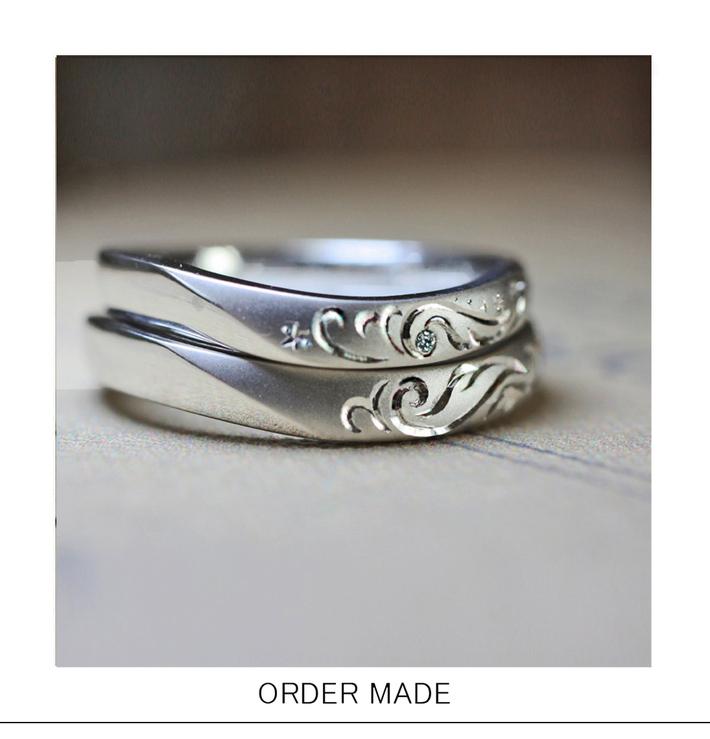トライバルエンジェル・天使の羽の柄の入った結婚指輪を重ねてハートをつくるオーダーリングのサムネイル