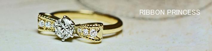 ゴールドリボンがモチーフになった ダイヤモンドエンゲージ・婚約指輪オーダーメイド