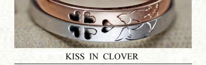ピンク&白のネコがクローバーでキスするオーダーメイドの結婚指輪の画像