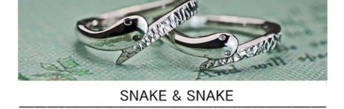 スネークデザインのプラチナ結婚指輪の目に輝くブラック&ホワイトダイヤの画像
