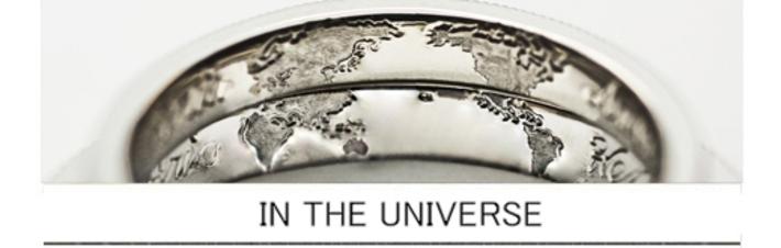 結婚指輪を重ねた内側に世界地図を描いたオーダーメイドリングの画像