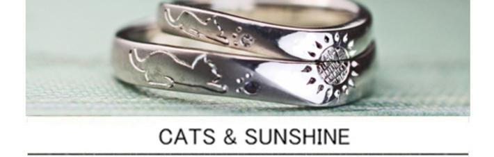 ネコとヒマワリを手彫りでデザインしたオーダーメイドの結婚指輪の画像
