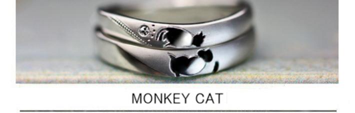 結婚指輪を重ねるとネコとお猿がチューしてるデザインのオーダー作品の画像